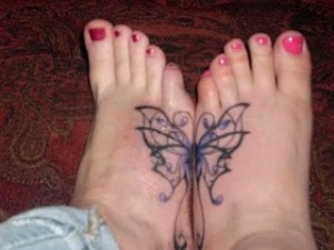 buterfly tattoos design on foot ideas