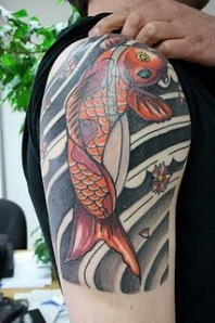 fish tattoos on arm design ideas